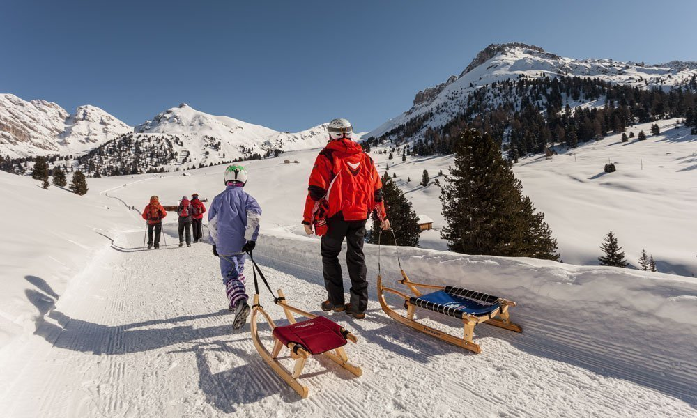 Winter holidays with tobogganing fun